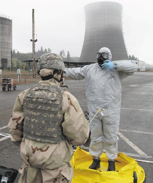 Soldiers practice decontamination protocol after a training scenario inside the nuclear reactor building at Satsop. Courtesy Satsop Business Park