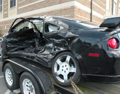 The car that a teenager died in is parked outside Roosevelt High School in Seattle, May 17, 2011.