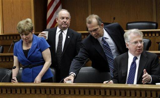 From left, Sen. Lisa Brown, D-Spokane, Sen. Mike Hewitt, R-Walla Walla, Sen. Joe Zarelli, R-Ridgefield, and Sen. Ed Murray, D-Seattle, take their seats to talk about a tentative budget agreement, Tuesday in Olympia.