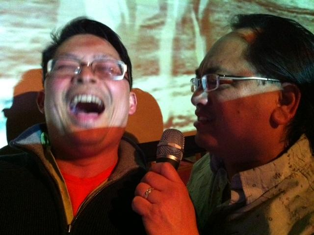 "On a quiet Sunday night, Harold Taw (left) and Alan Alabastro adopt stage names ""Balthazar"" and ""Ace"" at  the Bush Garden restaurant. The place, in Seattle's Chinatown-International District, has been a karaoke haunt for more than 30 years."
