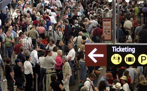 Crowds work their way through Sea-Tac Airport in this file photo.