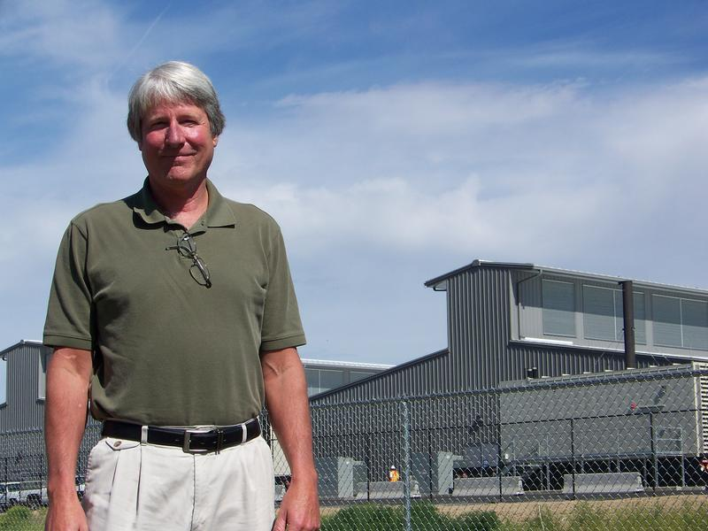 Tim Snead, Quincy's city administrator, stands in front of some of the new data centers that are being built on the edge of town.