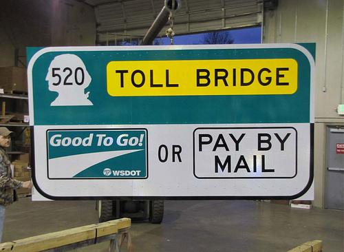 Toll charges for the 520 bridge might begin in August, but they might not.