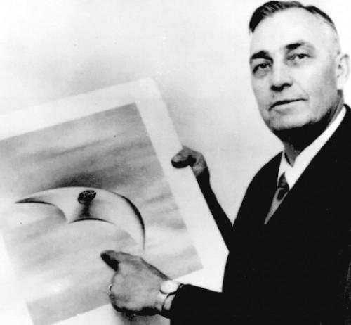 "Kenneth Arnold with an artist's rendering of the UFOs he saw, which he said flew ""like a saucer if you skipped it across the water."""
