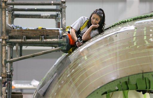 A Boeing employee works on an aft fuselage for the 787 Dreamliner inside the North Charleston, S.C., facility. Three S.C. Boeing employees have filed to be part of Boeing's suit against the NLRB.