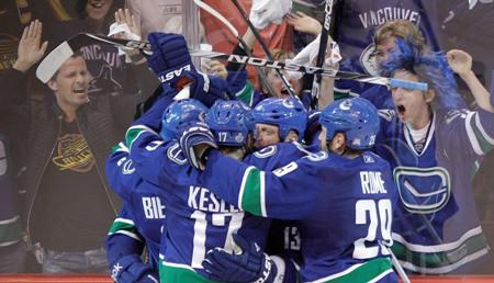 The Vancouver Canucks celebrate after scoring a goal against the Boston Bruins late in the third period to win Game 1 of the Stanley Cup Finals, Wednesday, June 1, 2011, in Vancouver.