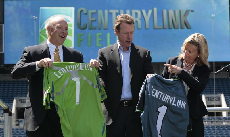 CenturyLink regional president Brian Stading, left, and executive vice president and COO Karen Puckett display the new jersey replacing the Qwest logo.