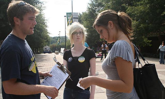 "George Mason University students help their peers register to vote in Washington, D.C. Young people in the ""other"" Washington, on the west coast, have the best access to the political process in the nation, according to a new survey."
