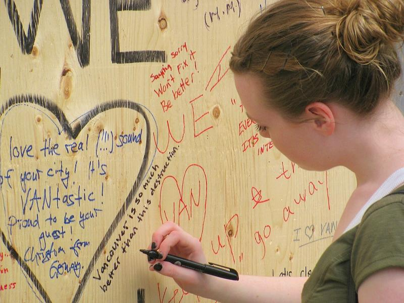 "Vancouver residents write messages such as ""We Love Van,"" ""The Real Vancouver is here today,"" ""Respect Our City"" and ""We love our Canucks…we don't love rioting fools."""