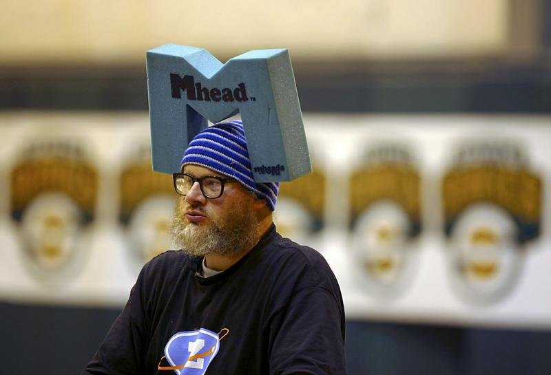 "Edward McMichael, pictured at a game in 2004, was a beloved Seattle street musician known as the ""Tuba Man."" He was found dead Nov. 3, 2008 from beating injuries he received in a robbery."