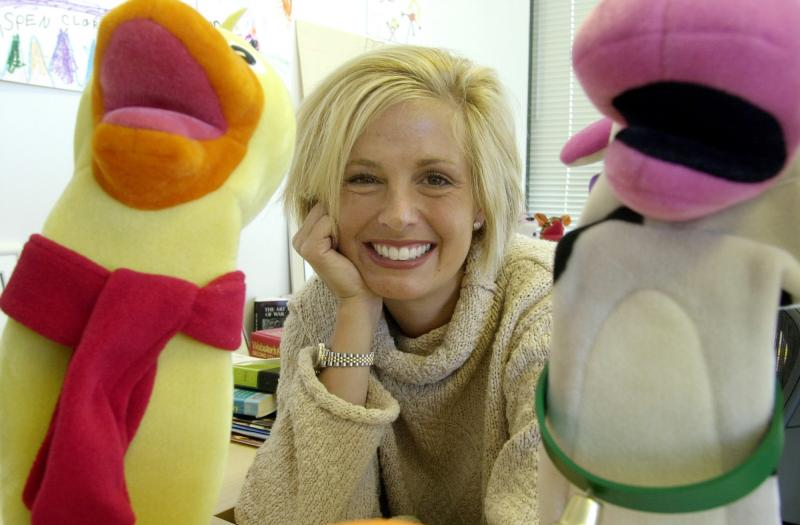 Baby Einstein co-founder Julie Aigner-Clark, framed by a couple of puppets used in Baby Einstein in 2001, said she was stung by a controversy started by a University of Washington study over whether the videos help babies learn or get in the way.