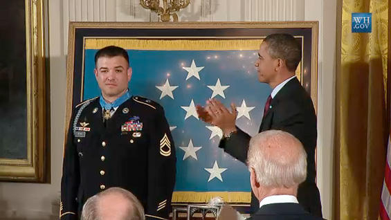 President Barack Obama applauds after putting the Medal of Honor around the neck of Sergeant First Class Leroy Petry in a ceremony at the White House Tuesday.