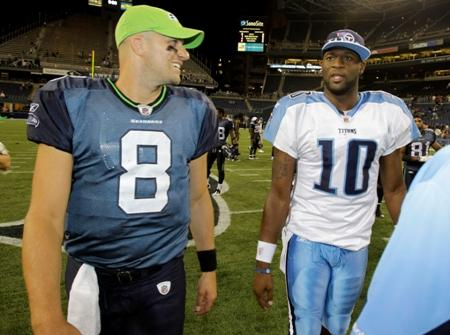 Former Seahawks quarterback Matt Hasselbeck is the new starting QB for the Tennessee Titans. Vince Young is being released by the team today. Here are the two in happier times – after a preseason game in Seattle in 2010.