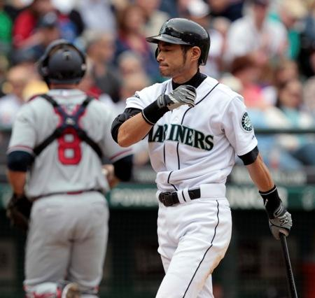 Ichiro heads back to the dugout after striking out during a game against the Braves last month. He's struggled at the plate and in the field this season and it's the first time in 10 years he wasn't elected to the All-Star team.
