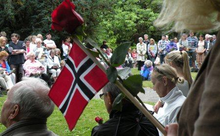 An overflow crowd listens to the vigil on speakers set up on the lawn of the Nordic Heritage Museum on July 27, 2011.