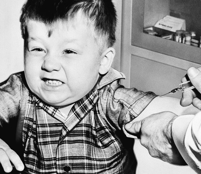 "Three-year-old Jeffery Trzeciak grimaces bravely as a doctor prepares to give him an anti polio inoculation in New Kensington, Pa., Feb. 23, 1957. The shots were given as part of "" Victory Over Polio Day."""