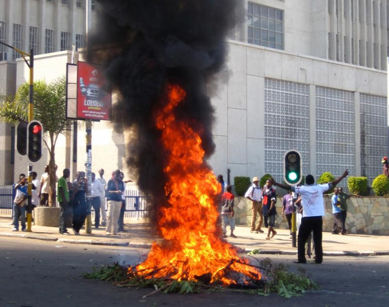 A protester burns vegetation in a street in Lilongwe, Malawi, last week. Protesters went on the rampage after a court injunction stopped them protesting the economic and democratic crisis in the country.