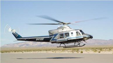 The Bell Helicopter that will perform the aerial survey has radiation detection equipment located in the capsules attached to its sides.