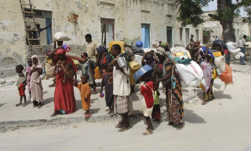 Somalis from southern Somalia carrying their belongings make their way to a new camp for internally displaced refugees in Mogadishu Tuesday. The U.N. will airlift emergency rations this week to parts of drought-ravaged Somalia.