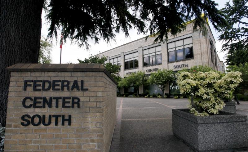 A federal building that houses the Seattle Military Processing Center pictured on June 23, 2011, in Seattle. Two men have been indicted in a plot to use machine guns and grenades in an attack on the military recruiting station there.