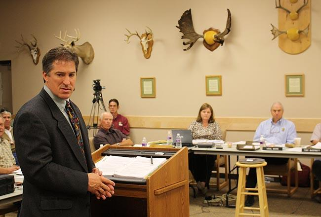 Idaho big game manager Jon Rachael presents a wolf hunting plan to the Idaho Fish and Game Commission in Salmon.