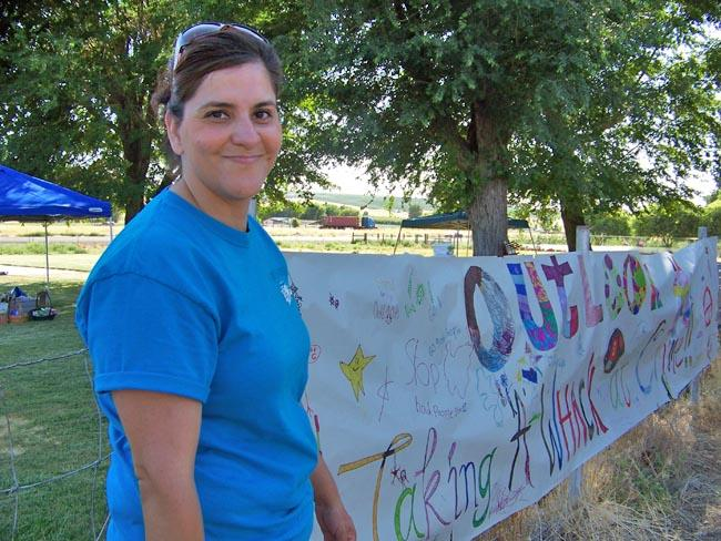 Petra Moreles leads the community group Stand Up For Outlook that's fighting back against gangs in the small Eastern Washington town. She helped organize an anti-gang picnic for children and adults near the town's church.
