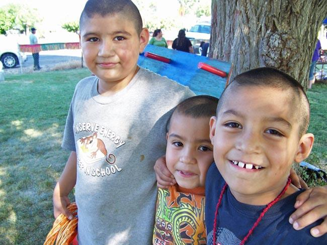 Manny Castillo, 9, and his brothers Jesus, 7, and Jr., 6, say they hide in their mother's room when they hear gunfire in their hometown of Outlook, Wash. They came out to play games and spend the evening with neighbors at a anti-gang picnic recently.