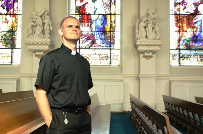 Dale Tuckerman, a 30-year-old seminarian for the Diocese of Spokane, stands in the Cathedral of Our Lady of Lourdes.