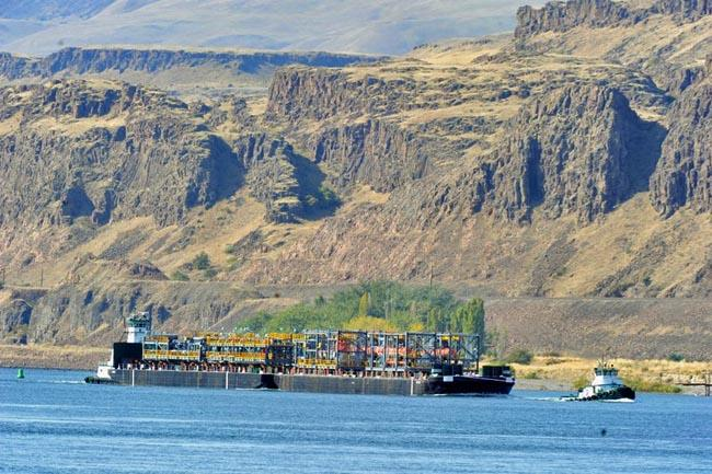 Pieces of an ExxonMobil refinery destined for Canada's oil sands travel up the Snake River to the Port of Lewiston in Idaho.