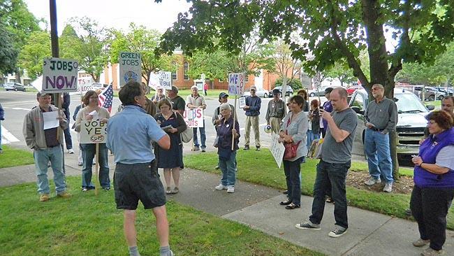 Demonstrators prepare to march to the Salem office of Democratic Congressman Kurt Schrader.