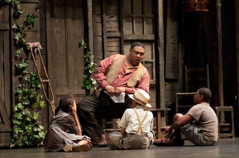 "Gordon Hawkins as Porgy with supernumeraries Esmé DeCoster, Keith Frasier, and Jahlil Ray in Seattle Opera's ""Porgy and Bess."""