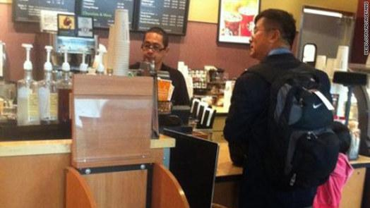 A screengrab from Sina Weibo shows the image of Gary Locke at SeaTac Airport Starbucks taken by a blogger named as TangChaohui_adSage.