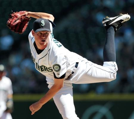New Mariners starting pitcher Charlie Furbush won his first game against the A's on Wednesday. He and left fielder Casper Wells are two trade acquisitions already proving their worth. It'll be a while before the other new players will get the chance.