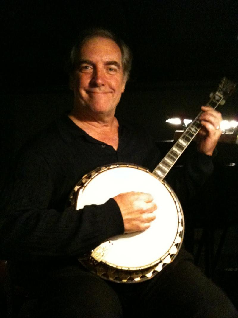 "John Patrick Lowrie holds the 1920s banjo he plays in Seattle Opera's ""Porgy and Bess."""