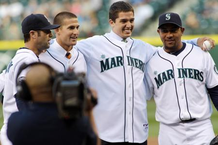 Newly signed Mariners Brad Miller, second from left, and Danny Hultzen, second from right, pose for a photo with Miguel Olivo and Adam Kennedy after they threw out the first pitches Wednesday night at Safeco Field.