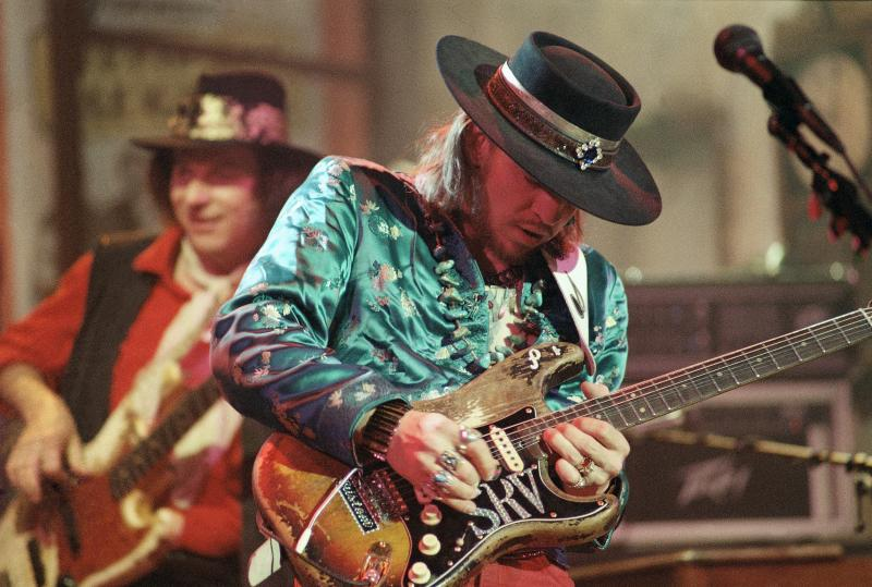 Guitarist Stevie Ray Vaughan rehearses with his band Double Trouble for a performance on Saturday Night Live in 1986.