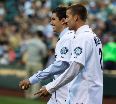 Newly signed Mariners Brad Miller, right, and Danny Hultzen, left, walk to the mound to throw out ceremonial first pitches prior Wednesday's game between the Mariners and the Toronto Blue Jays at Safeco Field.