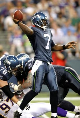 Seahawks quarterback Tarvaris Jackson sets to pass in the first half of last Saturday's preseason game against the Minnesota Vikings. Some wonder whether he's the best choice for starting QB.