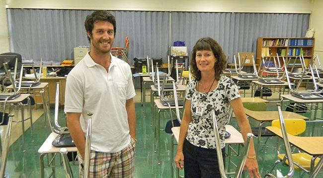 Eric Phillips welcomes mentor Karen Herinckx into his classroom at Judson Middle School in Salem.