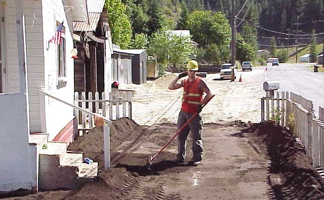 A worker replaces contaminated soil with clean soil as part of the yard clean-up program in Idaho's Silver Valley.