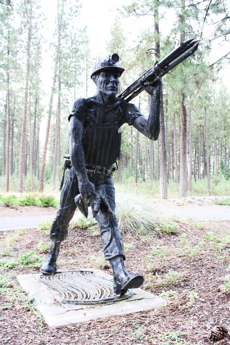 A statue of a miner stands outside Hecla Mining's headquarters in Coeur d'Alene, Idaho. The company owns the Lucky Friday Mine in Mullan, Idaho, where miner Larry Marek died in April.