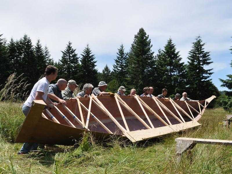 It took a dozen men to lift the Chinook canoe at the boat builder's shop earlier this year. The canoe will replace the one stolen by William Clark during the Lewis and Clark Expedition.