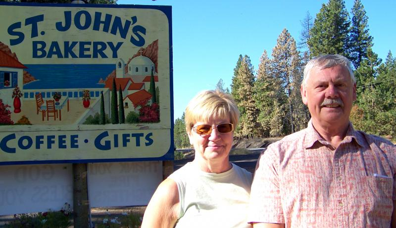 Klickitat County Commissioner Rex Johnston and his wife Donna, stand near the spot where a fire broke out that later became known as the Monastery Complex Fire near Goldendale, Wash.