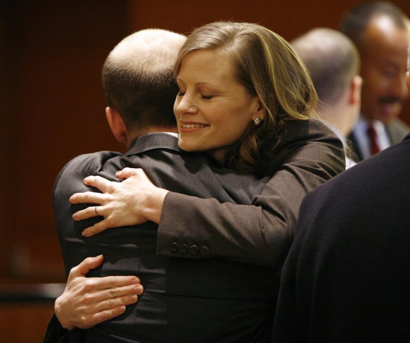 Amy Wales is hugged by a well wisher after a ceremony in 2006 honoring her slain father, Assistant United States Attorney Thomas C. Wales.
