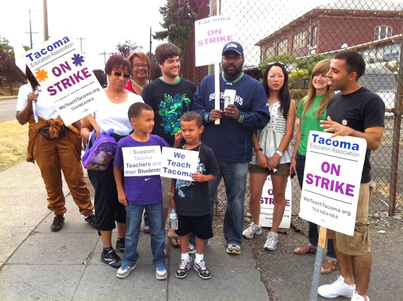 Picketers pose for a photograph outside the MicKinley Elementary in Tacoma Wednesday.
