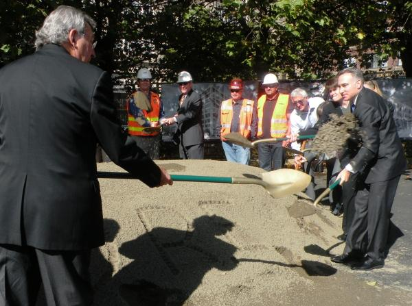 King County Executive Down Constantine and former Seattle Mayor Charley Royer join in the ground breaking of Stadium Place, a building project in Pioneer Square.