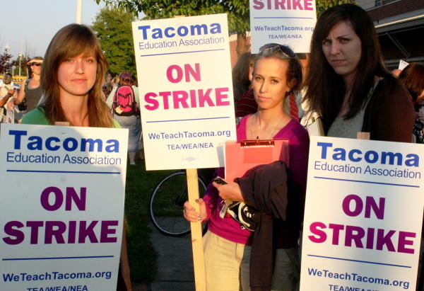 Tacoma teachers grab their picket signs after voting with an 87 percent majority to boycott the district.