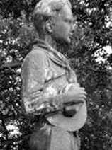 The top of the 6-foot McKenzie statue of a Boy Scout youth that was stolen from the Creighton Scout Service Center over the weekend.