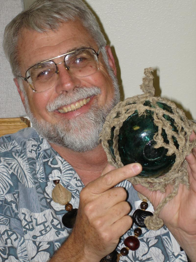 World renown oceanographer, author and beachcomber Curtis Ebbesmeyer with a find from the ocean.