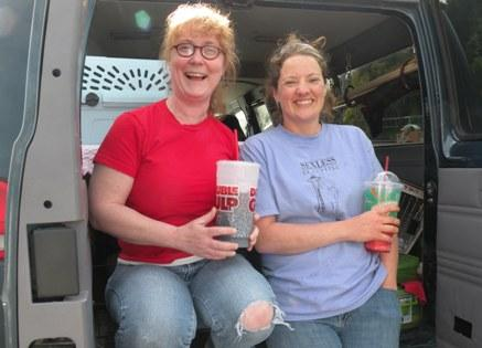 Aimee Stambach and Jamie Pederson take a break from cat trapping in Grays Harbor County.  They've converted a Metro carpool van can carry up to 50 cats.